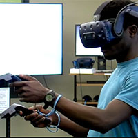 Student wearing virtual reality headset.
