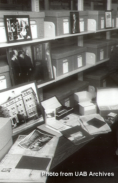 Several photographs on a table in the UAB Archives department
