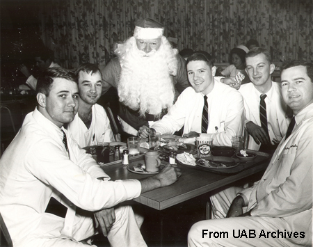 Five male students pose with Santa Claus