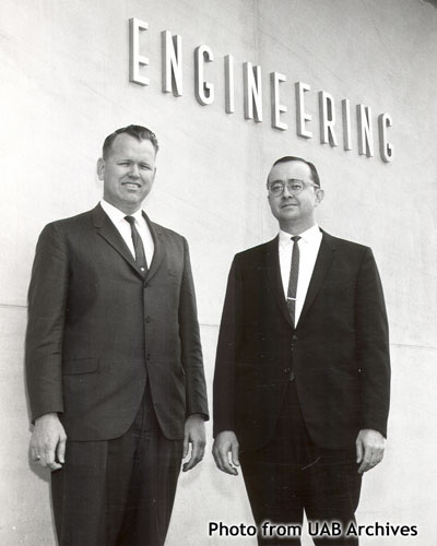 Two men stand outside the engineering building