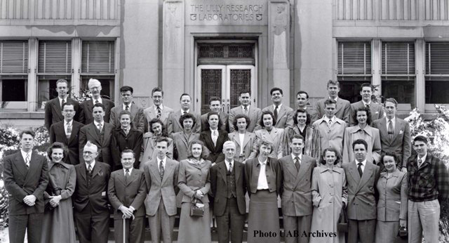 The Class of 49 stands on steps for a photo