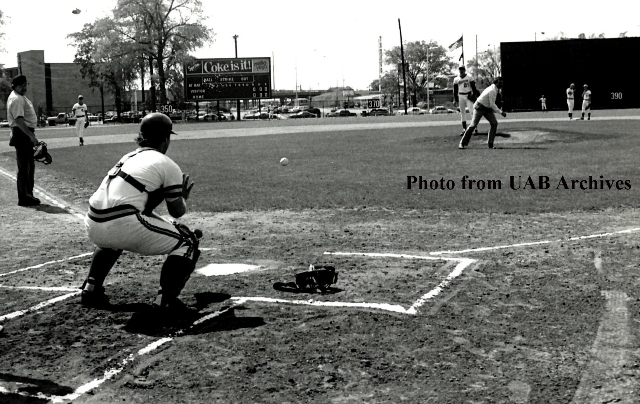 Brooks Robinson throws a baseball towards the catcher