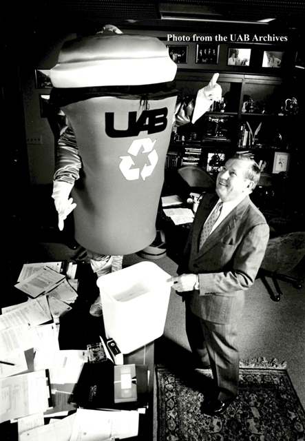 Trash Gordon, UAB's recycling mascot, stands next to President Charles A. McCallum Jr.
