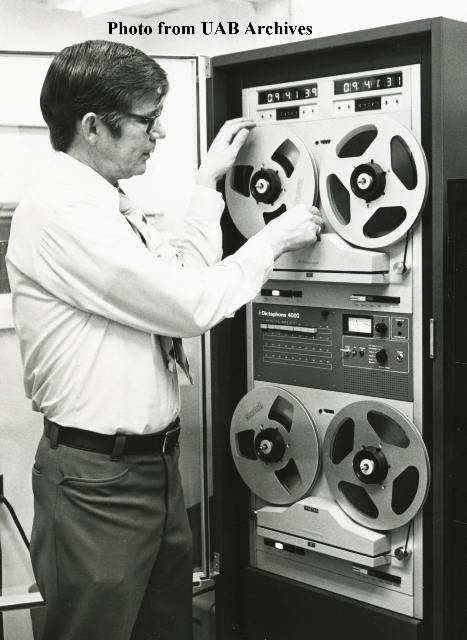 A policeman adjusts a tape machine