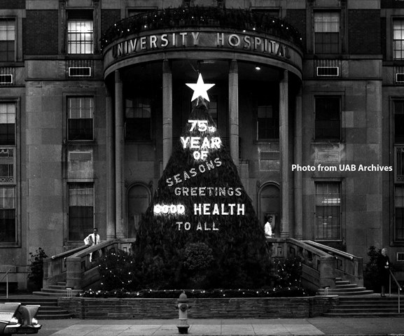 Outside of University Hospital with a lit up Christmas tree sign