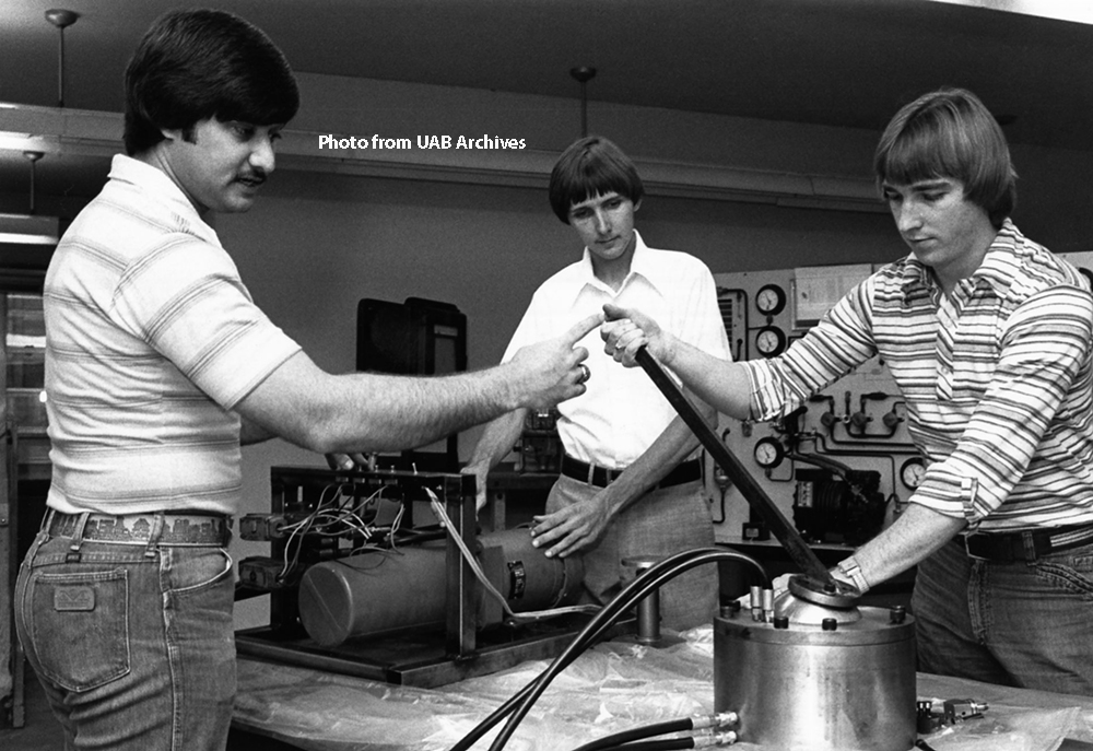 Engineering students assemble a mechanical arm, June 1978.