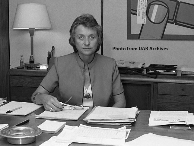Dean Milly Cowles at her desk, 1980