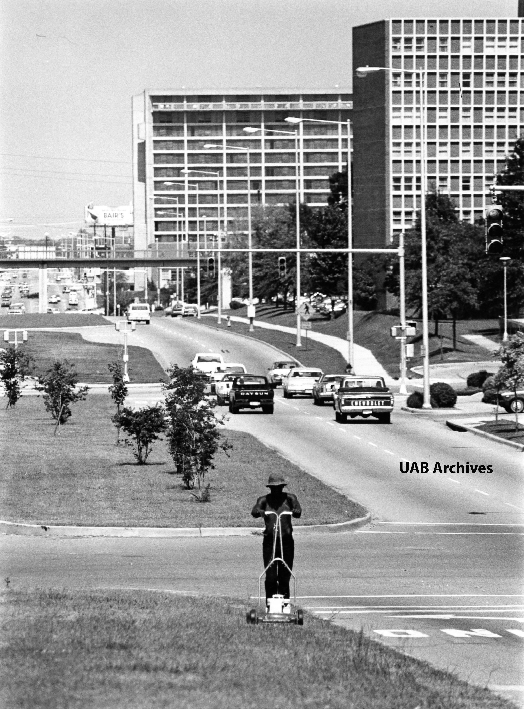 Mowing the median along Eighth Avenue South, 1979